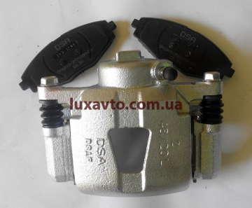 Суппорт Шевроле Ланос 1.5 передний (Сhevrolet Lanos), Дэу Нексия 1.5 (Daewoo Nexia), ЗАЗ Сенс (Sens) Корея DSA заводской левый с колодками